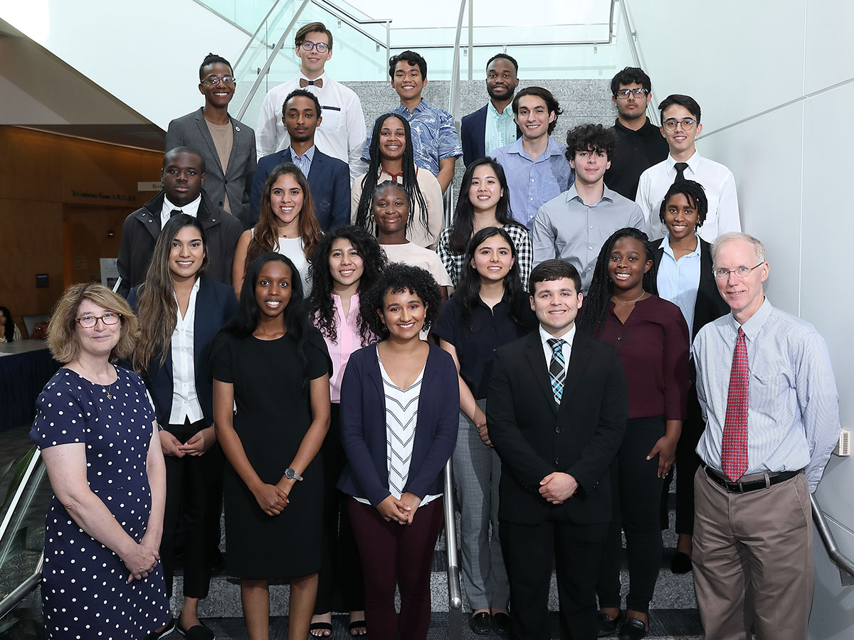 Student participants in the STEP-UP Summer Undergraduate Program are seen in 2017. The large group of students are pictured in two rows, one standing behind another that is seated. The program is designed for underrepresented students.