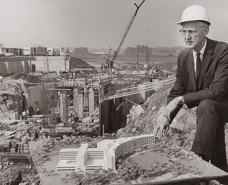 Founding dean and CEO George Harrell, MD, pictured in 1966 with an architectural model, oversees initial construction of the Medical Center and College of Medicine.
