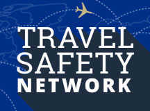 The Penn State University Travel Safety Network logo depicts the words Travel Safety Network in large block letters atop an outline map of the world with dotted flightpaths and a single plane above the lettering.