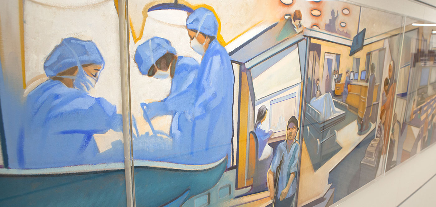 A painting is seen in the hallway of Penn State College of Medicine. It depicts scenes from campus, including surgeons at work, a sheet-draped person in a hospital bed and more, in soft neutral tones.