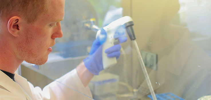 Matthew Lauver, a graduate student in the Penn State College of Medicine Department of Microbiology & Immunology, is seen at work in a department lab in July 2016.