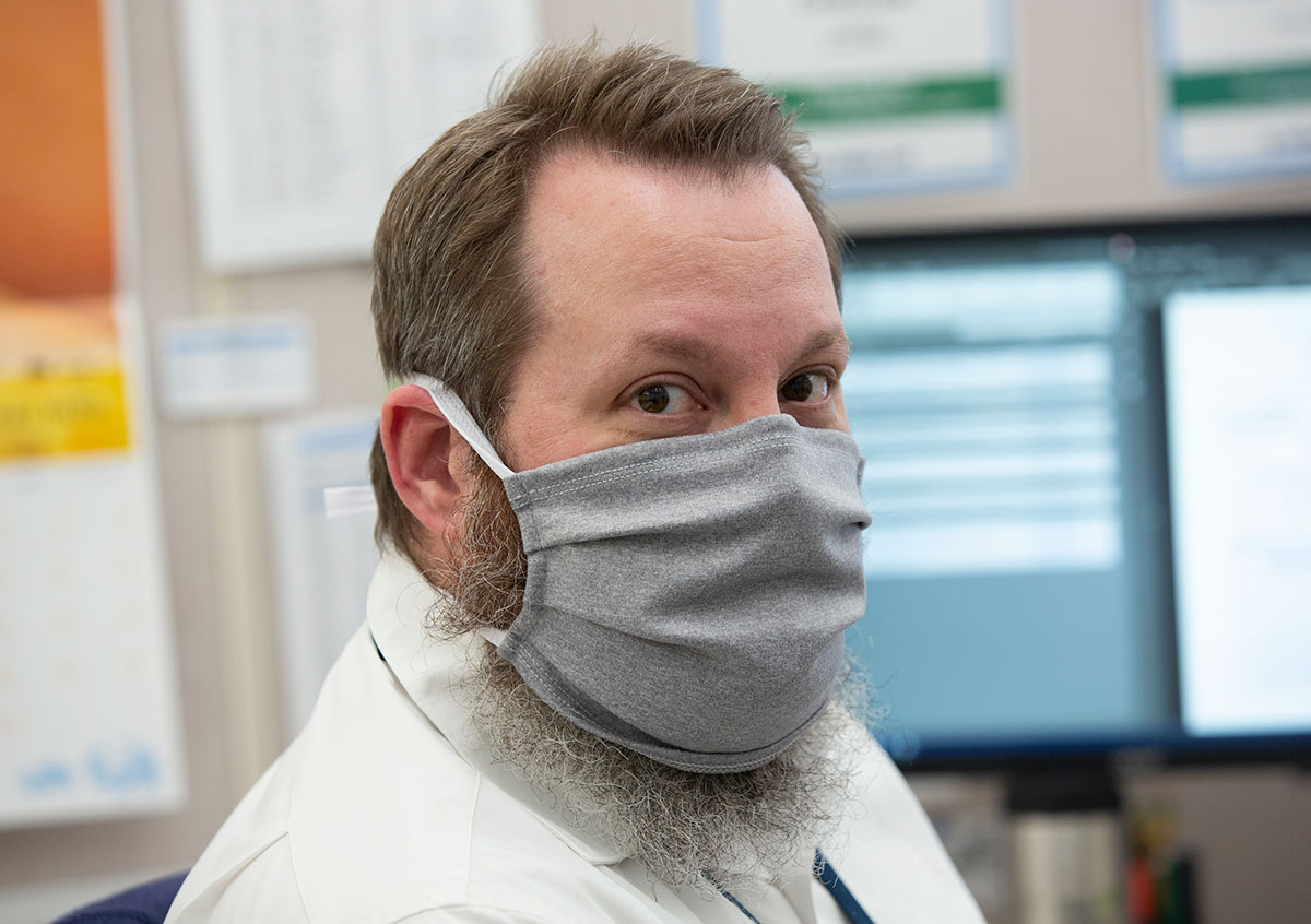 Richard Miller of facilities is seen wearing a cloth mask, which non-clinical and non-laboratory staff working on campus at the College of Medicine have been given and must wear.